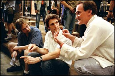 First assistant director Bill Clark, prooducer Lawrence Bender and Quentin Tarantino on the set. The director wants Kill Bill to be an homage to classic martial arts films, down to the right kind of